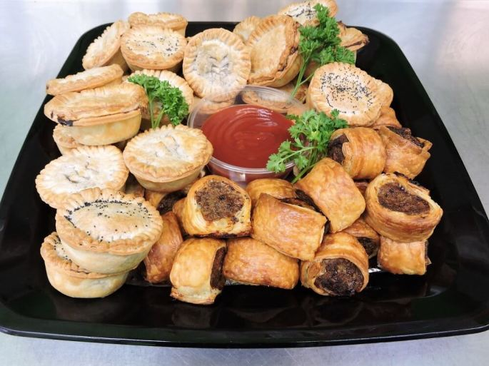 homemade mini pies and beef sausage rolls catering platter
