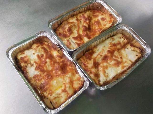 Three individual servings of beef lasagne