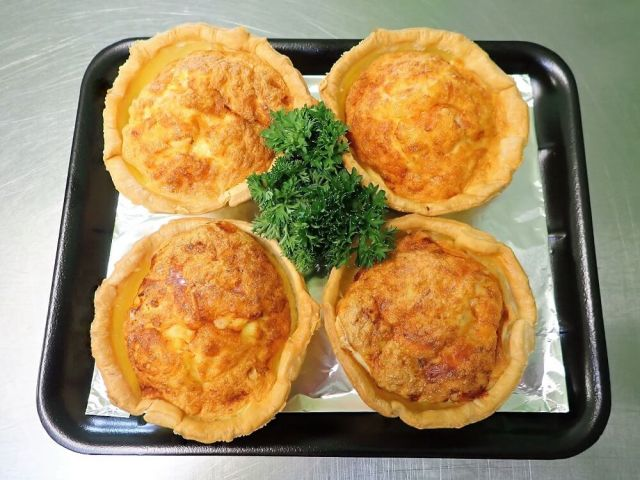 Four individual meal size quiches